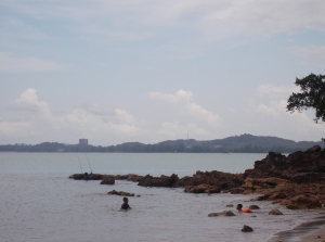 View of the right hand side of Teluk Buih, with Mersing in the background. Some try their luck and fish at the rocks. (@all rights reserved)