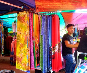 Stall offering ready-cut pieces of cloth for making the traditional Malay dress, the Baju Kurung. (@all rights reserved)
