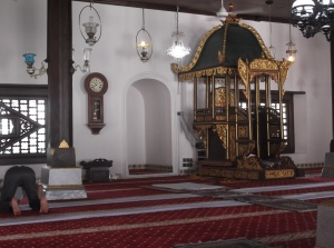 The interior of Masjid Kampung Hulu. Taking pride of place at the head of mosque is the mimbar (pulpit), where the imam delivers his weekly khutbah (sermon) during Friday prayers. (@ all rights reserved)