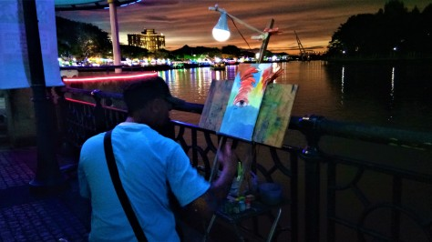 The Artist At The Kuching Waterfront